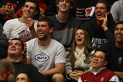 Dec 20, 2011; Stanford CA, USA;  Stanford Cardinal quarterback Andrew Luck (left) laughs in the stands during the second half against the Tennessee Lady Volunteers at Maples Pavilion.  Stanford defeated Tennessee 97-80. Mandatory Credit: Jason O. Watson-US PRESSWIRE