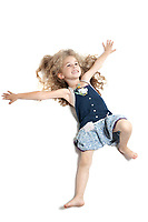 caucasian little girl full length laying happy isolated studio on white background