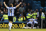 Sheffield Wednesday midfielder Ross Wallace (33) scores a goal and celebrates to make the score 1-0 during the Sky Bet Championship play-off first leg match between Sheffield Wednesday and Brighton and Hove Albion at Hillsborough, Sheffield, England on 13 May 2016. Photo by Simon Davies.