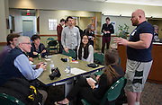 Volunteer John Herbert talks to participants of Startup Weekend Athens at the Ohio University Innovation Center on March 18, 2016. Herbert encouraged everyone to offer an idea pitch for the weekend.