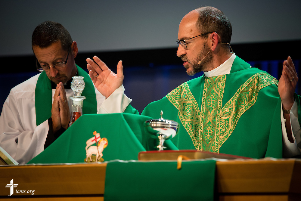 The Rev. Peter C. Bender, pastor of Peace Lutheran Church in Sussex, Wis., prays with the Rev. William Weedon, chaplain of the LCMS International Center, during the Opening Divine Service of the 66th Regular Convention of The Lutheran Church–Missouri Synod on Saturday, July 9, 2016, at the Wisconsin Center in Milwaukee. LCMS/Frank Kohn