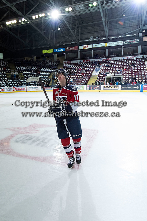 KELOWNA, CANADA - MARCH 27: Ty Comrie #11 of Tri-City Americans exits the ice after warm up against the Kelowna Rockets on March 27, 2015 at Prospera Place in Kelowna, British Columbia, Canada.  (Photo by Marissa Baecker/Getty Images)  *** Local Caption *** Ty Comrie;