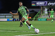 Forest Green Rovers Ebou Adams(14) passes the ball forward during the EFL Sky Bet League 2 match between Forest Green Rovers and Scunthorpe United at the New Lawn, Forest Green, United Kingdom on 7 December 2019.