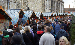 Pre-Christmas crowds are flocking to the shops and seasonal markets in Winchester,UK. No obvious signs on spending cuts in this historic British city. Sunday, 8th December 2013. Picture by i-Images