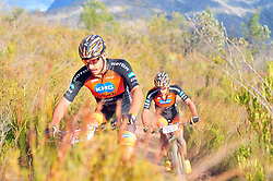 WELLINGTON SOUTH AFRICA - MARCH 22: Victor Koretzky and Jodan Sarrou during stage three's 111km from Wellington to Worcester on March 22, 2018 in Western Cape, South Africa. Mountain bikers gather from around the world to compete in the 2018 ABSA Cape Epic, racing 8 days and 658km across the Western Cape with an accumulated 13 530m of climbing ascent, often referred to as the 'untamed race' the Cape Epic is said to be the toughest mountain bike event in the world. (Photo by Dino Lloyd)