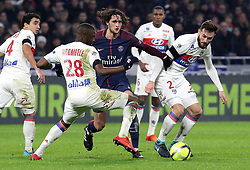 LYON, January 21, 2018  Adrian Rabiot (C) from Paris Saint-Germain competes with Lucas Tousart of Olympique Lyonnais (R) during the match of the 22nd round of 2017-18 French Ligue 1 in Lyon, France on January 21, 2018. Olympique Lyonnais won 2-1. (Credit Image: © Olivier Farin / Xinhua/Xinhua via ZUMA Wire)