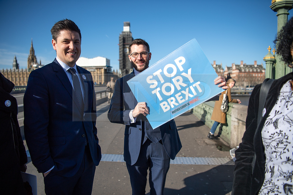 © Licensed to London News Pictures. 05/03/2019. London, UK.  MP Paul Sweeney (Glasgow North), Centre  - MPs drop a banner reading Love Socialism Hate Brexit over Westminster Bridge and light red flares in a stunt which prompted police to clear the demonstrating members of parliament. MPs pictured on the bridge are:<br /> <br /> Clive Lewis,  <br /> Lloyd Russell Moyle,  <br /> Kate Osamor,  <br /> Marsha de Cordova, <br /> Sandy Martin, <br /> Alex Sobel,  <br /> Preet Gill,  <br /> Rachael Maskell,  <br /> Luke Pollard,  <br /> Chi Onwurah, <br /> Paul Sweeney,  <br /> Ged Killen, <br /> Rupa Huq,  <br /> <br /> Photo credit: Guilhem Baker/LNP