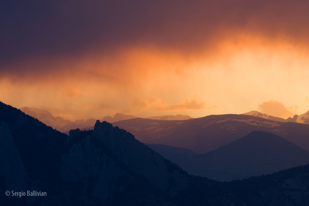 A cloudy sunset over the Rocky Mountains near Boulder, CO
