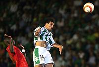 Betis' Capi wins a header over Liverpool's Momo Sissoko during their Champions League match in Ruiz de Lopera stadium in Seville, Spain, Tuesday 13 September, 2005. (Photo / Alvaro Hernandez)
