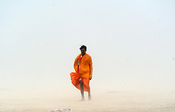 June 16, 2017 - Allahabad, Uttar Pradesh, India - Indian pedestrians walk through a dust storm at the Sangam, the confluence of the Ganges, Yamuna and mythical Saraswati rivers in Allahabad. (Credit Image: © Prabhat Kumar Verma via ZUMA Wire)