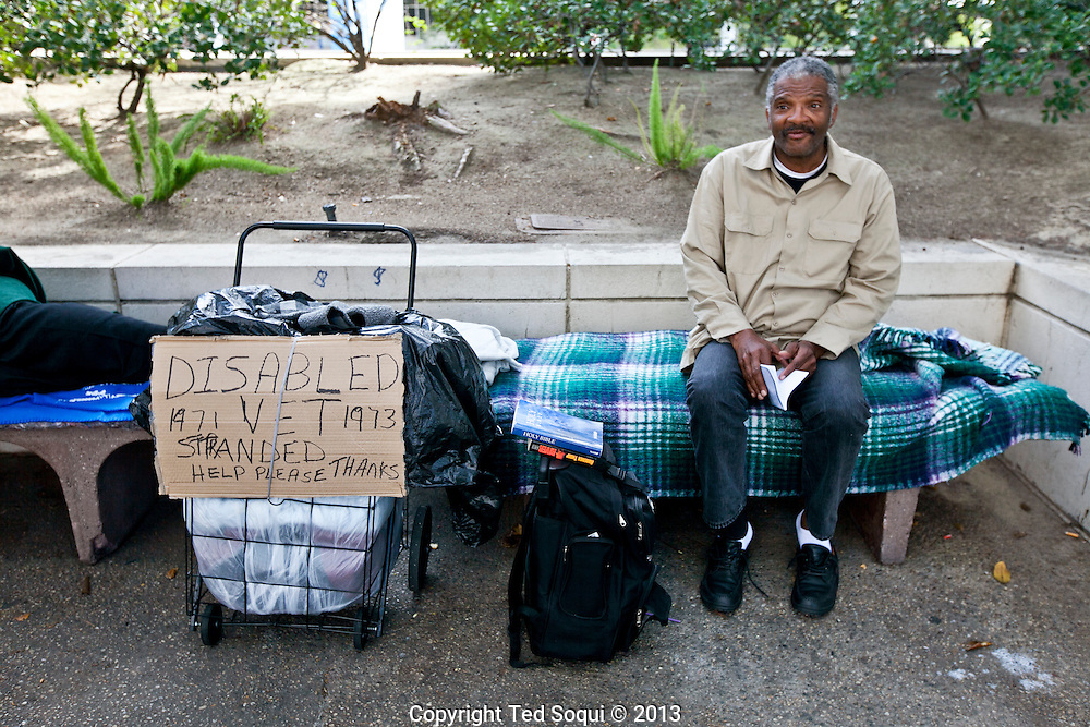 A disabled homeless Vietnam Veteran with his camp in downtown LA.
