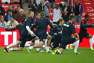 Picture by Andrew Tobin/Focus Images Ltd +44 7710 761829<br /> 14/08/2013<br />  Wayne Rooney of England (L) shares a joke with Steve Gerrard in warm up during the International Friendly match at Wembley Stadium, London.