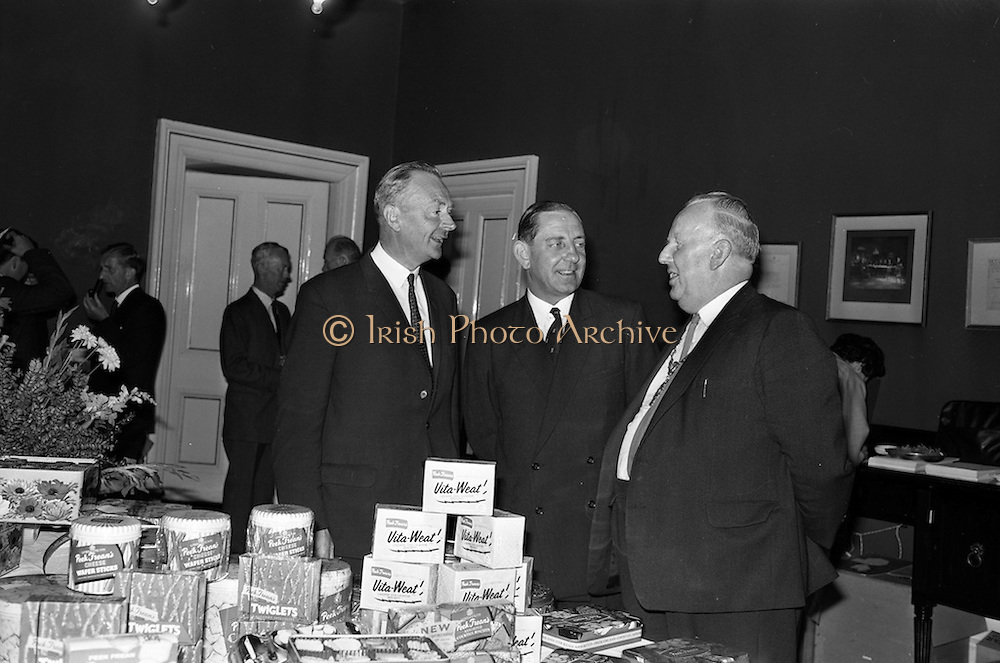 12/06/1963<br /> 06/12/1963<br /> 12 June 1963<br /> F.A. Wyatt and Co. Ltd./Peek Frean reception at the Shelbourne Hotel, Dublin. At the F.A. Wyatt presentation of the products of Peek Fream Biscuits were: Mr. T.S. Maharry, Managing Director, F.A. Wyatt and Co. Ltd.; Mr. A.M.A. Battle, Export Sales Manager Peek Frean and Co. Ltd. and Alderman J.J. O'Keeffe T.D., Lord Mayor of Dublin.