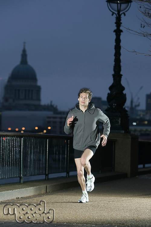 Runner training on early winter morning in London