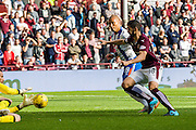 Kilmarnock FC Forward Josh Magennis attacks agains \Hearts FC DefenderIgor Branco during the Ladbrokes Scottish Premiership match between Heart of Midlothian and Kilmarnock at Tynecastle Stadium, Gorgie, Scotland on 3 October 2015. Photo by Craig McAllister.