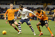 Wolverhampton Wanderers defender Ethan Ebanks-Landell and Wolverhampton Wanderers midfielder George Saville attempt to hold up Preston North End striker Joe Garner during the Sky Bet Championship match between Wolverhampton Wanderers and Preston North End at Molineux, Wolverhampton, England on 13 February 2016. Photo by Alan Franklin.