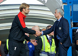 LONDON, ENGLAND - Saturday, October 31, 2015: Liverpool's manager Jurgen Klopp shakes hands with Chelsea manager Jose Mourinho after his side's 3-1 victory during the Premier League match at Stamford Bridge. (Pic by Lexie Lin/Propaganda)
