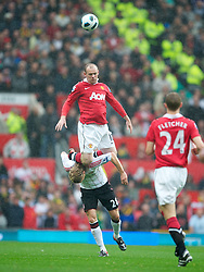 MANCHESTER, ENGLAND - Sunday, September 19, 2010: Liverpool's Christian Poulsen is kneed in the back of the head by Manchester United's Wayne Rooney during the Premiership match at Old Trafford. (Photo by David Rawcliffe/Propaganda)