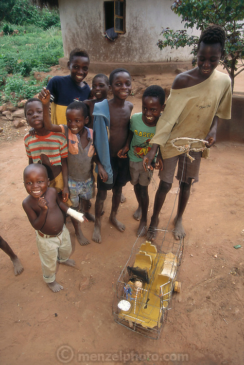 A group of South African village children play with a home made toy bus, fashioned out of scrap wire. Tshamulavhu village, Mpumalanga, South Africa. Image from the book project Man Eating Bugs: The Art and Science of Eating Insects.