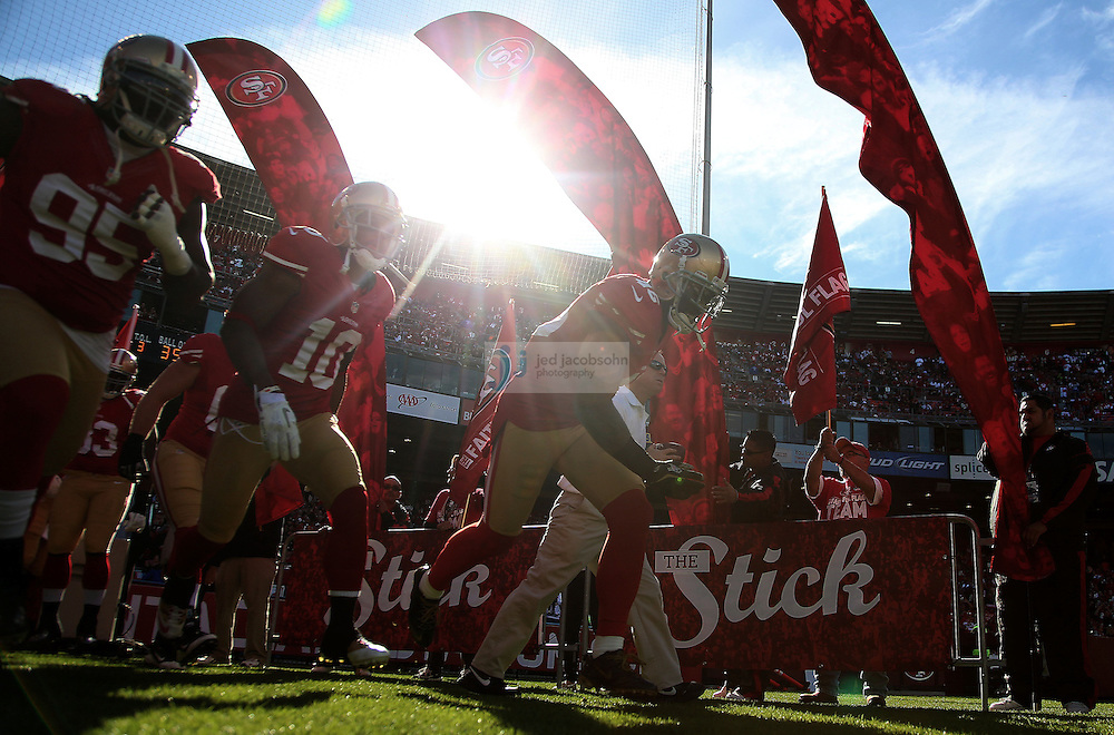 Members of the San Francisco 49ers enter the field against the St. Louis Rams , Sunday, Nov. 11, 2012 at Candlestick Park, in San Francisco, Ca.