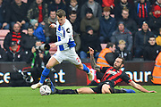 Solly March (20) of Brighton and Hove Albion is fouled by Steve Cook (3) of AFC Bournemouth during the The FA Cup 3rd round match between Bournemouth and Brighton and Hove Albion at the Vitality Stadium, Bournemouth, England on 5 January 2019.