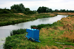 UK ENGLAND CAMBRIDGESHIRE 7AUG06 - Diesel pump and piping next to The Great Ouse, a tributary of the River Cam, supplying water for agricultural land in the Fenlands, Cambridgeshire...jre/Photo by Jiri Rezac..© Jiri Rezac 2006..Contact: +44 (0) 7050 110 417.Mobile:  +44 (0) 7801 337 683.Office:  +44 (0) 20 8968 9635..Email:   jiri@jirirezac.com.Web:    www.jirirezac.com..© All images Jiri Rezac 2006 - All rights reserved.