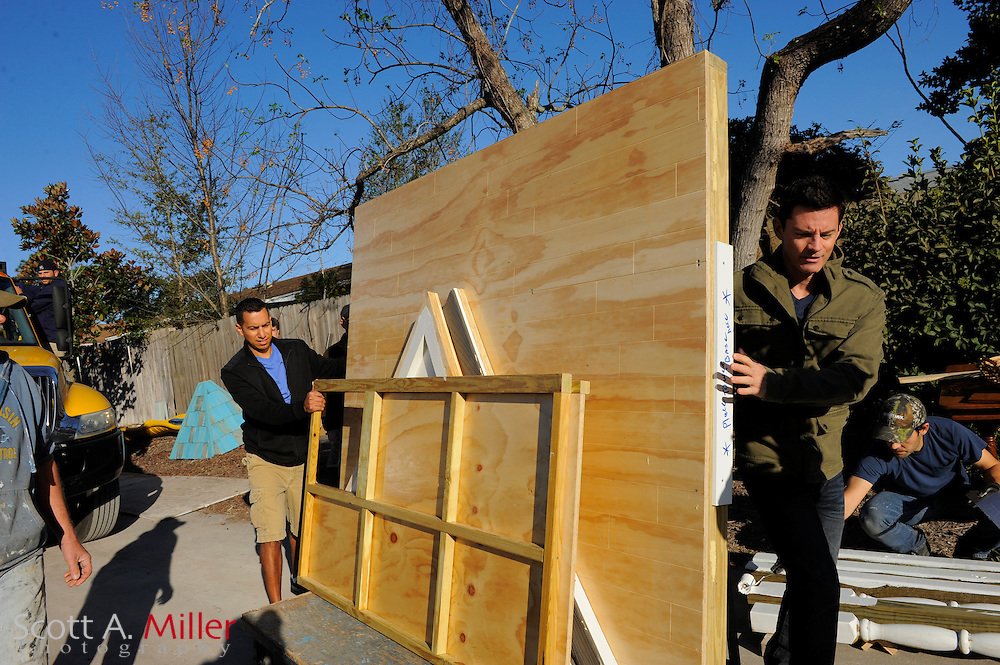 Show host Brandon Johnson, right, and homeowner Geo Morales bring in one of the first pieces of what will become a Rapunzel Castle as they join crew members in transforming the backyard into a Woodland Fantasyland, including a village, a castle, a train garden and even a miniature golf course for dwarfs, all based on daughter Kayla's drawing. The Morales children, including Kayla, 5, and Emma, 3, have followed in their parents' footprints with their love of all things Disney and especially enjoy meeting the princesses and Cinderella Castle at Disney's Magic Kingdom Resort in Orlando, FL. As seen on HGTV's My Yard Goes Disney.