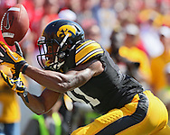 August 31 2013: Iowa Hawkeyes wide receiver Kevonte Martin-Manley (11) can't pull in a pass during the first quarter of the NCAA football game between the Northern Illinois Huskies and the Iowa Hawkeyes at Kinnick Stadium in Iowa City, Iowa on August 31, 2013. Northern Illinois defeated Iowa 30-27.