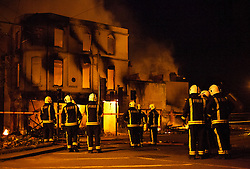 © Licensed to London News Pictures. 09/08/2011 LONDON, UK. Firefighters deal with the House of Reeves furniture store in Croydon after it was set alight by rioters in the town.  Croydon was one of several London boroughs and English cities hit by a third night of rioting and looting. Photo credit: Matt Cetti-Roberts/LNP