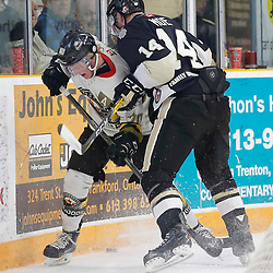 "TRENTON, ON  - MAY 2,  2017: Canadian Junior Hockey League, Central Canadian Jr. ""A"" Championship. The Dudley Hewitt Cup. Game 2 between Powassan Voodoos and Trenton Golden Hawks. Rex Moe #14 of the Trenton Golden Hawks makes the hit on  Dayton Murray #20 of the Powassan Voodoos <br /> (Photo by Amy Deroche / OJHL Images)"