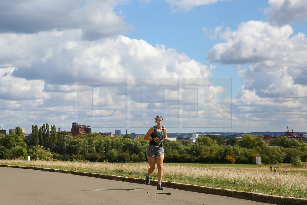 © Licensed to London News Pictures. 01/09/2019. London, UK. A jogger jogs on a warm and sunny morning on the first day of meteorological autumn in Alexandra Palace park in north London. Photo credit: Dinendra Haria/LNP