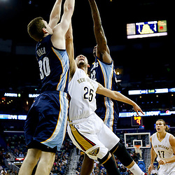 Dec 13, 2013; New Orleans, LA, USA; New Orleans Pelicans shooting guard Austin Rivers (25) shoots over Memphis Grizzlies power forward Jon Leuer (30) and power forward Ed Davis (32) during the second quarter of a game at New Orleans Arena. Mandatory Credit: Derick E. Hingle-USA TODAY Sports