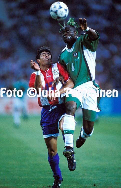 FIFA World Cup - France 1998.Toulouse, Paraguay v Nigeria.Taribo West (Nigeria) v Hugo Brizuela (Paraguay).©JUHA TAMMINEN
