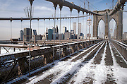 Brooklyn Bridge with snow on the walk path