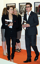 Image licensed to i-Images Picture Agency. 12/06/2014. Brad Pitt and Angelina Jolie tour an art exhibition  on day three of the End Sexual Violence in Conflict  Global Summit in London.  Picture by Stephen Lock / i-Images