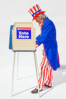 Uncle Sam at a voting booth on a white background...Model Release: 20080813_MR_A