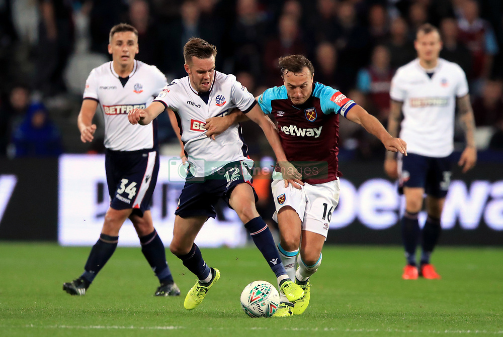 Bolton Wanderers' Craig Noone, left battle for the ball with West Ham United's Mark Noble, right