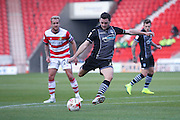 Colchester United midfielder Drey Wright (7) with a shot  during the EFL Sky Bet League 2 match between Doncaster Rovers and Colchester United at the Keepmoat Stadium, Doncaster, England on 15 October 2016. Photo by Simon Davies.