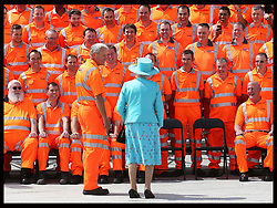 Image licensed to i-Images Picture Agency. 17/07/2014. Reading, United Kingdom. The Queen talks to construction workers before posing for a group photograph with them after opening Reading Railway Station in Berkshire, United Kingdom, to mark a £895 million (pounds sterling)  re-development of the station.  Picture by Stephen Lock / i-Images