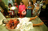 """Jay Ortmann, 43 of Spring Lake, NJ lies on a gurny, dressed in his """"Autopsy"""" Halloween costume at the Club Fizz Halloween Party at the Sheraton Bucks County in Langhorne, PA."""