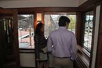 People came out Friday evening for the final After Hours event of April at the Robie where they were treated to food, music and tours of the historic house. The Robie House is located at 5757 S. Woodlawn.<br /> <br /> 2452, 2453 – Stephen Arlington and Nelat Yulong spend time in onf of the many corridors of the house.