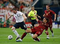 Photo: Glyn Thomas.<br />England v Portugal. Quarter Finals, FIFA World Cup 2006. 01/07/2006.<br /> England's Wayne Rooney (L) and Portugal's Fernando Meira.