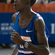 Martin Lel of Kenya, winner of the 2007 New York City Marathon,  passes the 26.1 mile marker.  The race was 26.2 miles long.  Lel finished in 2 hours 9.03 minutes.