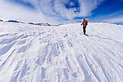 Backcountry skier under Piute Pass, Inyo National Forest, Sierra Nevada Mountains, California USA