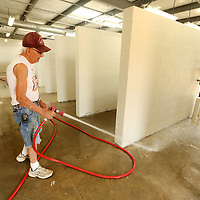 Billy Wildman, a contracted painter with Southland Construction, cleans the floor in one of the kennel areas of the new Tupelo-Lee Humane Society's building preparing it for a clear coat sealer on Thursday morning. Officials say staff will start moving in July 1, but the organization still needs a final $200,000 to retire its debt from the building. The Tupelo-Lee Humane Society will be hosting a variety of fundraising activities this wummer to work on the debt.