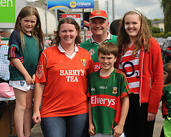 Divided loyalties Helen McManamon from Bandon with husband Kieran McManamon originally from Ballycroy with kids Ciara, Aoife and  Eoin on their way to the Gaelic grounds.<br /> Pic Conor McKeown