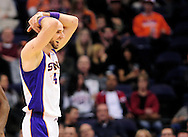 Jan. 24, 2012; Phoenix, AZ, USA; Phoenix Suns center Marcin Gortat (4) reacts on the court while playing against the Toronto Raptors during the second half at the US Airways Center. The Raptors defeated the Suns 99-96. Mandatory Credit: Jennifer Stewart-US PRESSWIRE..