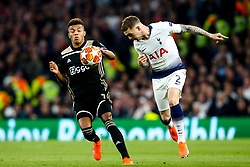 Kieran Trippier of Tottenham Hotspur heads the ball past David Neres of Ajax - Mandatory by-line: Robbie Stephenson/JMP - 30/04/2019 - FOOTBALL - Tottenham Hotspur Stadium - London, England - Tottenham Hotspur v Ajax - UEFA Champions League Semi-Final 1st Leg
