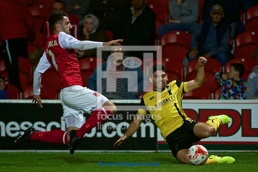 Conor McLaughlin of Fleetwood Town (left) and Joe Dudgeon of Barnsley during the Sky Bet League 1 match at the Highbury Stadium, Fleetwood<br /> Picture by Ian Wadkins/Focus Images Ltd +44 7877 568959<br /> 17/09/2014
