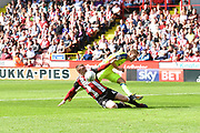 Sheffiled United midfielder John Fleck (4) does sliding tackle on Derby County forward Matej Vydra (23) in the penalty area during the EFL Sky Bet Championship match between Sheffield Utd and Derby County at Bramall Lane, Sheffield, England on 26 August 2017. Photo by Ian Lyall.